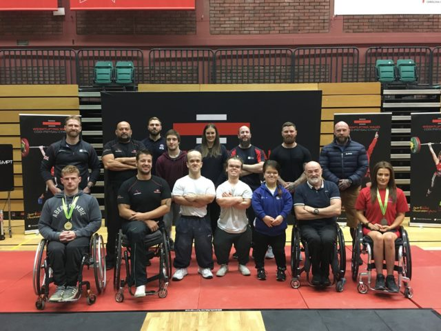 Para Powerlifters with their medals and coaches