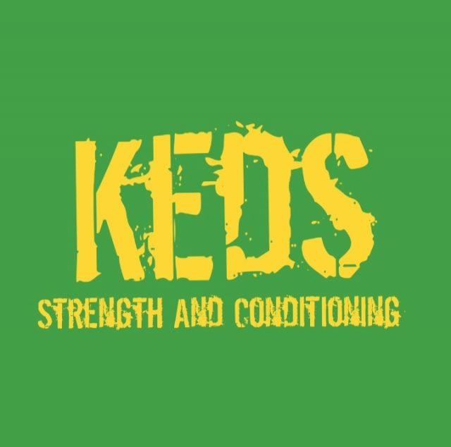 Keds logo greeen backgruond yellow text