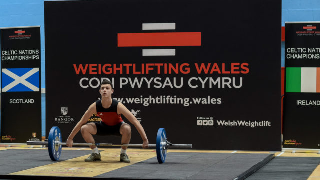 Youth Male lifter taking a Snatch attempt in competition