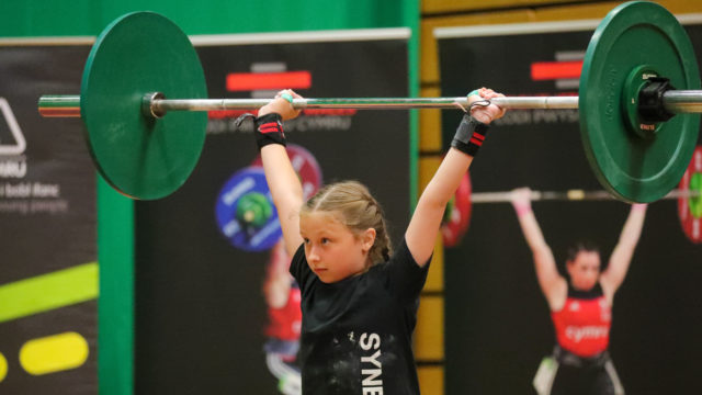 Youth female lifter lifting in competition
