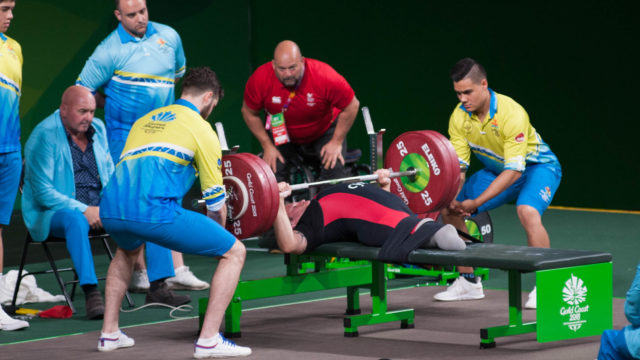 JIM HORNER coaching lifter during Commonwealth Games 2022